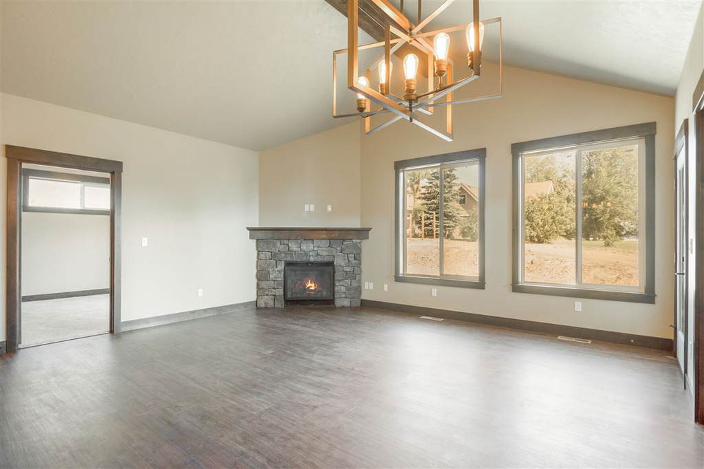 Interior shot showing fireplace & vaulted ceilings a