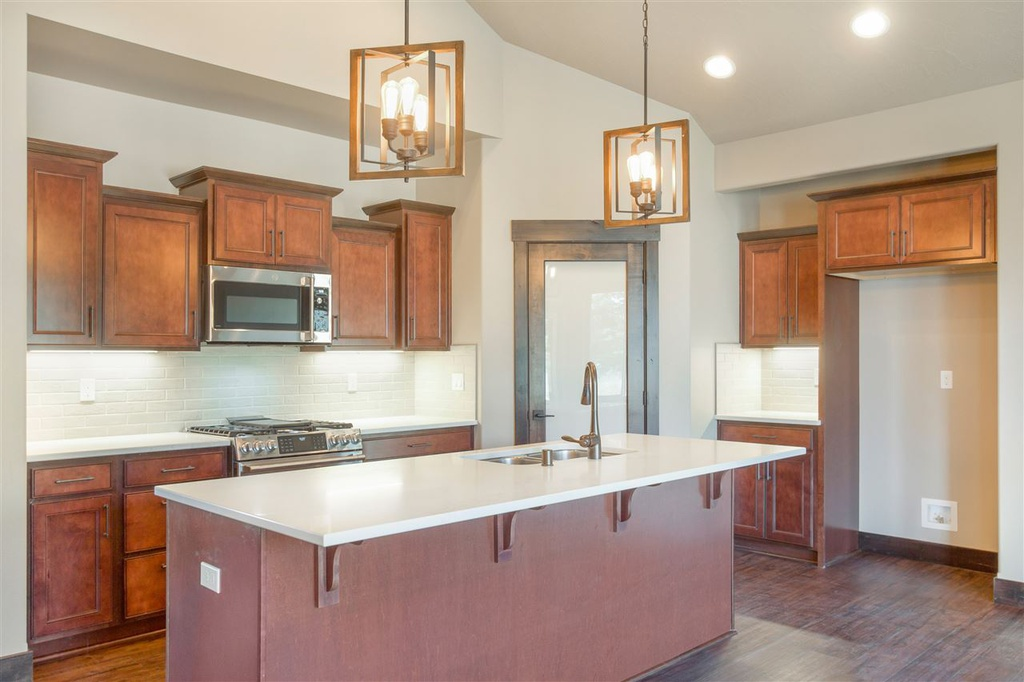 Shows kitchen Island and cabinets